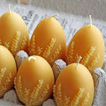 Beeswax egg candles with lavender design in egg carton