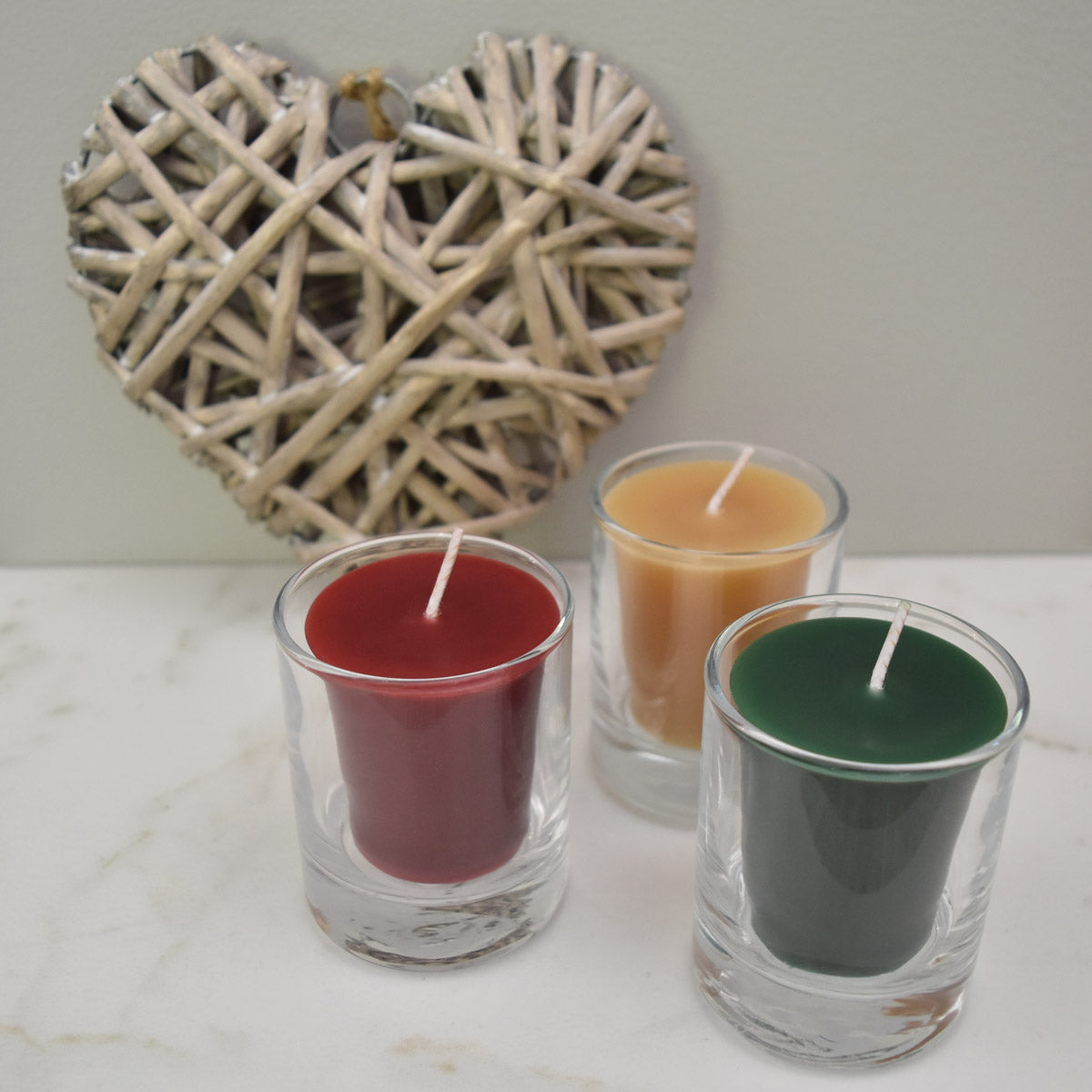 Red yellow and green bees wax votive candles for gift ideas