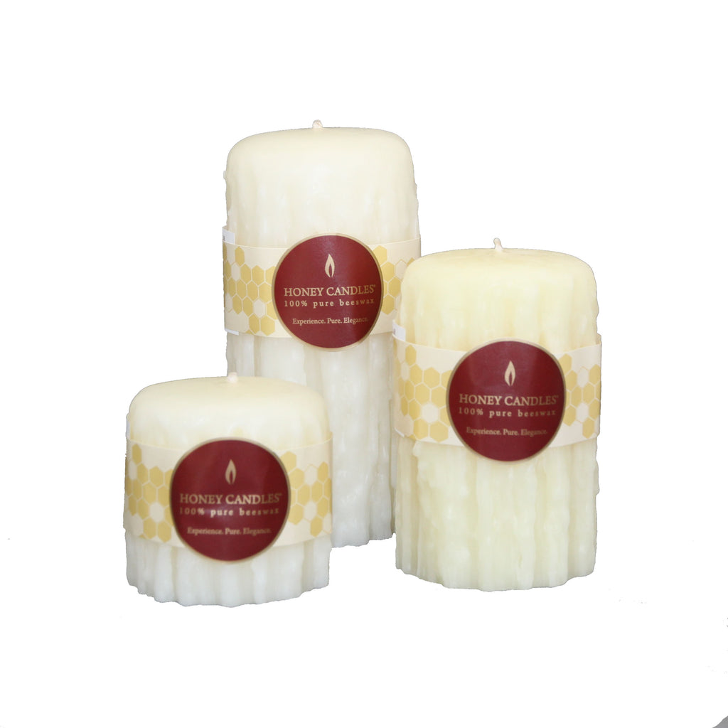 Three unique heritage dipper round pillar beeswax candles in white