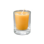 single natural votive beeswax candle in a clear cup