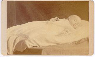 1860's CDV post mortem of a baby infant, flowers in hand.