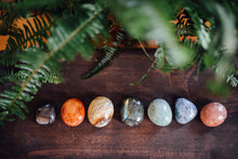 Load image into Gallery viewer, Seven raw polished stones for chakra healing and crystal healing including hematite, carnelian, gold agate, labradorite, amazonite, sodalite, and peach moonstone