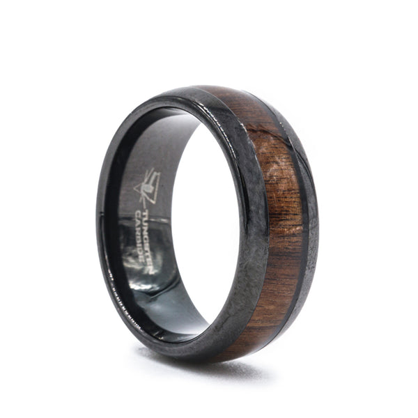 Black Tungsten Carbide wedding ring with koa wood inlay and polished rounded edges.