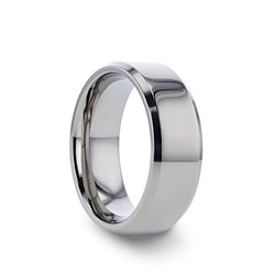 Titanium wedding ring with raised polished center and beveled edges.