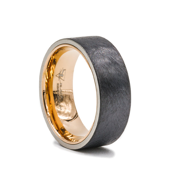 Black Zirconium flat men's wedding band with distressed center featuring a rose gold plated sleeve.