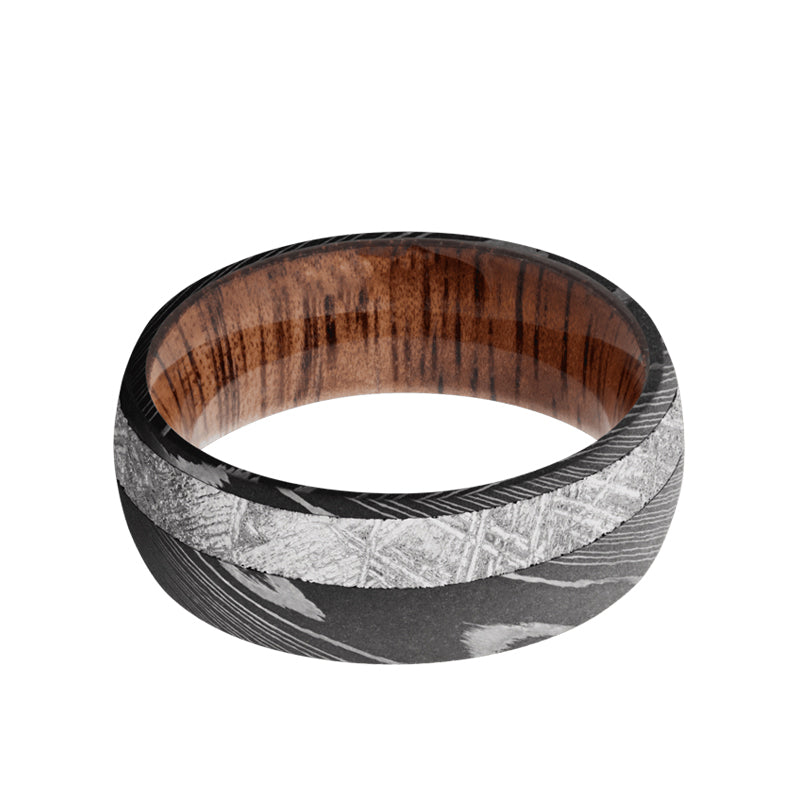 Damascus domed men's wedding band with 3mm of meteorite inlaid off center featuring a Koa wood sleeve.