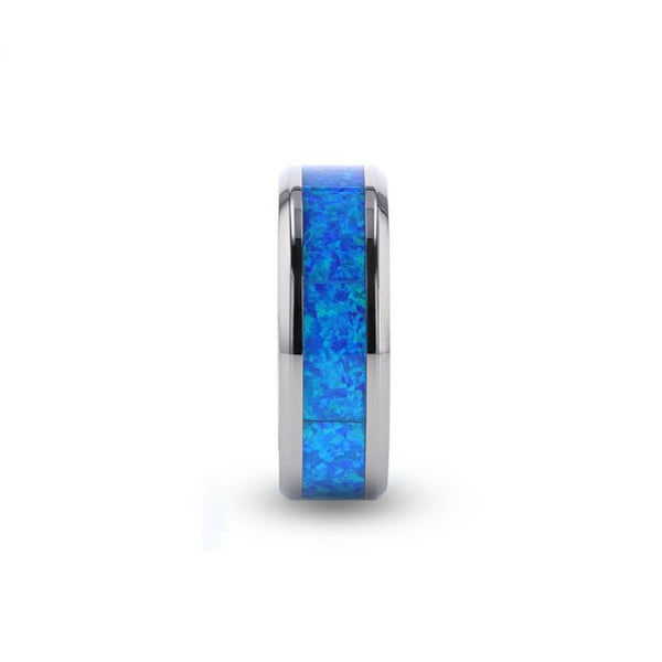 Titanium men's wedding ring with blue green opal inlay and beveled edges.