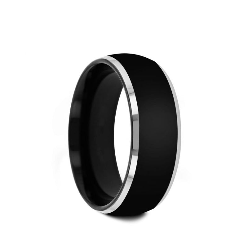 Black Tungsten domed men's wedding ring with polished finish and metallic beveled edges.