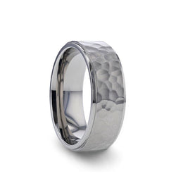 Titanium wedding ring with raised hammered center and polished step edges.
