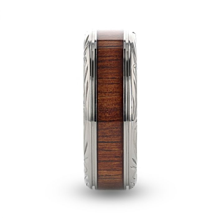 Titanium wedding ring with rare koa wood inlay and intricate edge design.