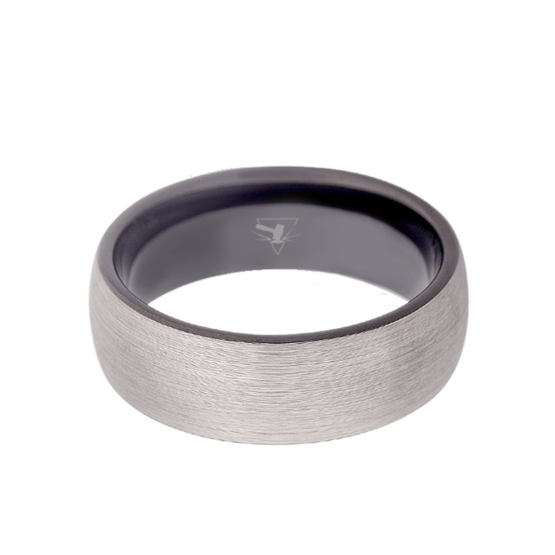 Titanium domed men's wedding band with brushed center featuring a black sleeve and black rounded edges.