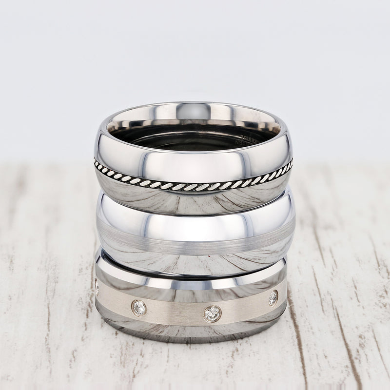 Beveled Tungsten Carbide ring with platinum inlay set with diamonds