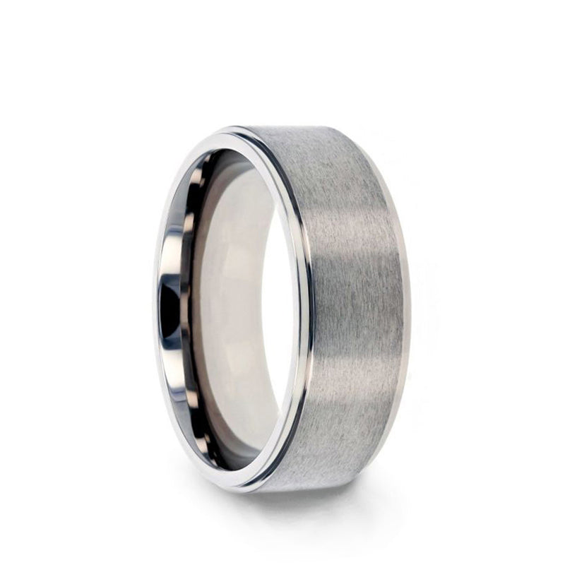 Titanium men's wedding ring with raised, brushed center and polished step edges.