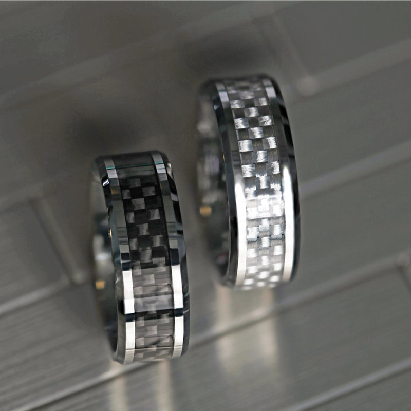 Tungsten wedding band with beveled edges and black carbon fiber inlay