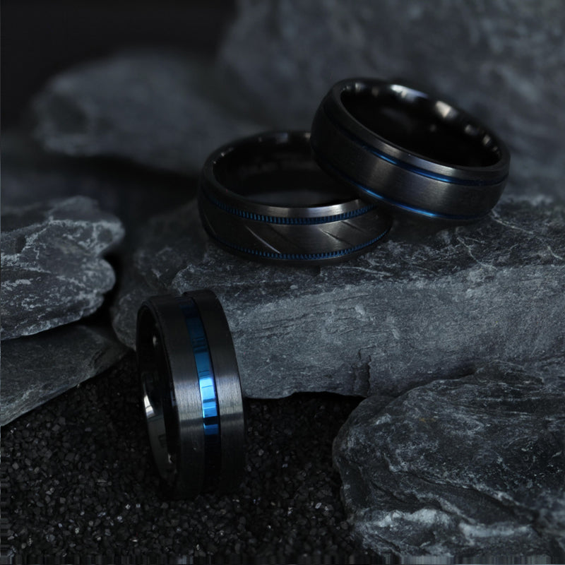 Black Titanium men's wedding ring with brushed center, blue grooves and carved diagonal pattern