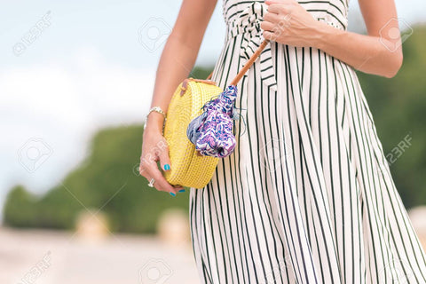 products/100267061-woman-with-fashionable-stylish-yellow-rattan-bag-and-silk-scarf-outside-tropical-island-of-bali-indo.jpg