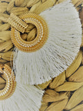 Gold studded and white tassel earrings