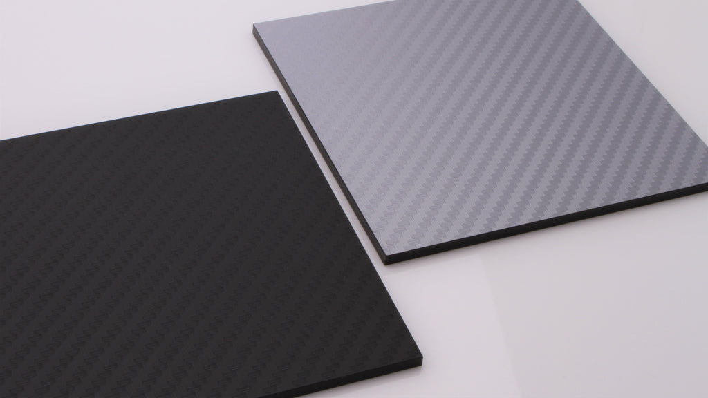 Black and silver carbon fibre acrylic samples