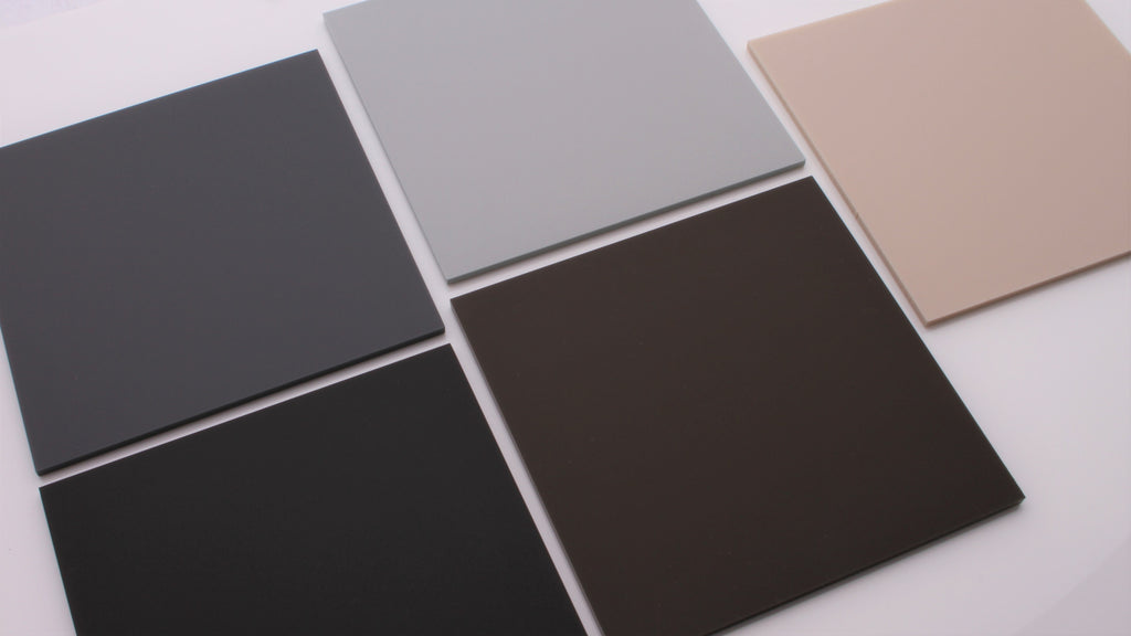 Five matte natural acrylic samples in dark grey, light grey, black, brown and sand