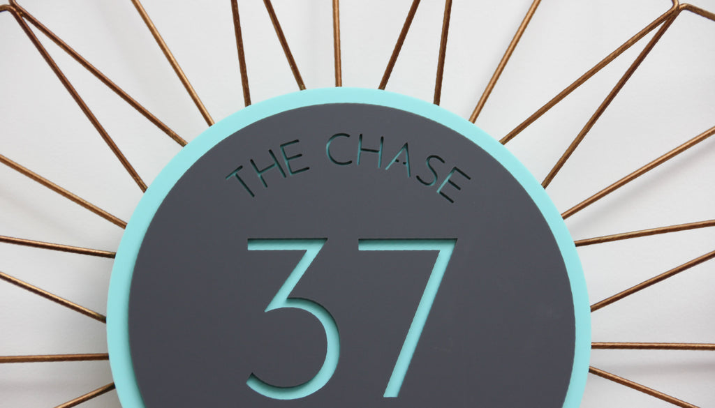 Round House Sign on Geometric Shape