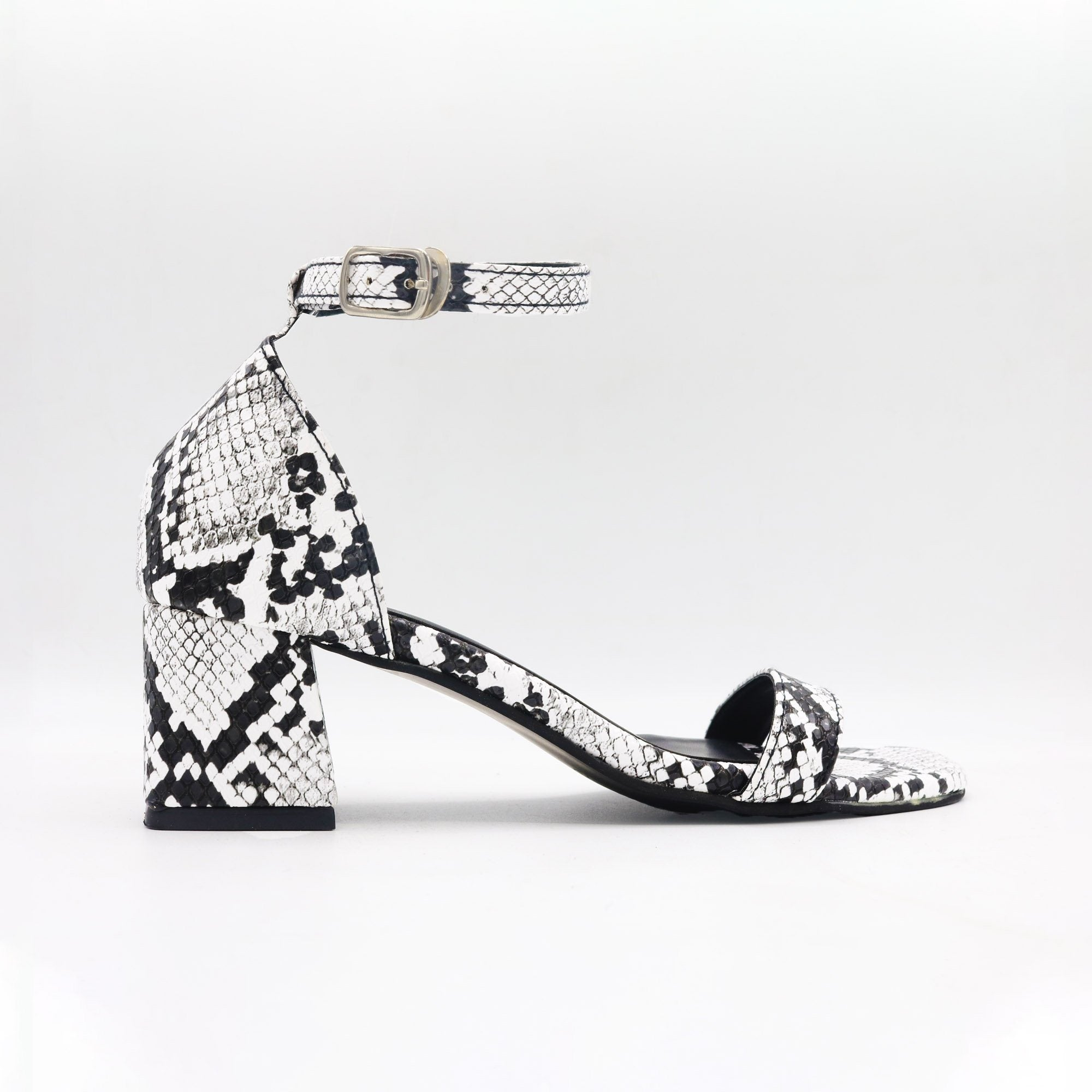 Black & White Snake Low Block Heels by Madish