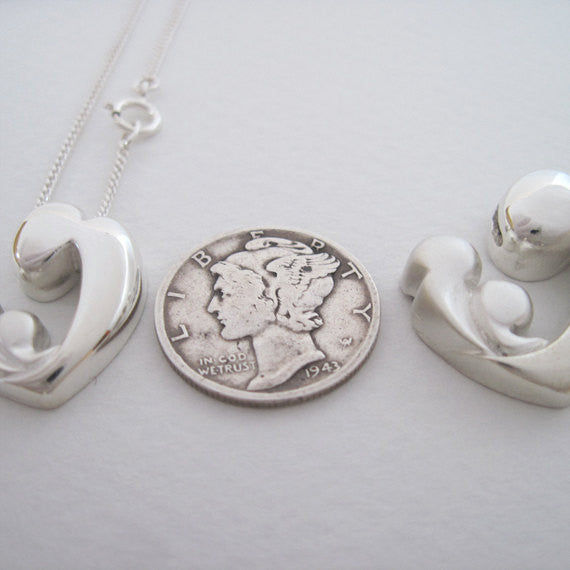 Mother and children pendant necklace two sisters gallery mother and children pendant necklace aloadofball Image collections