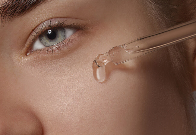 applying face serum closeup