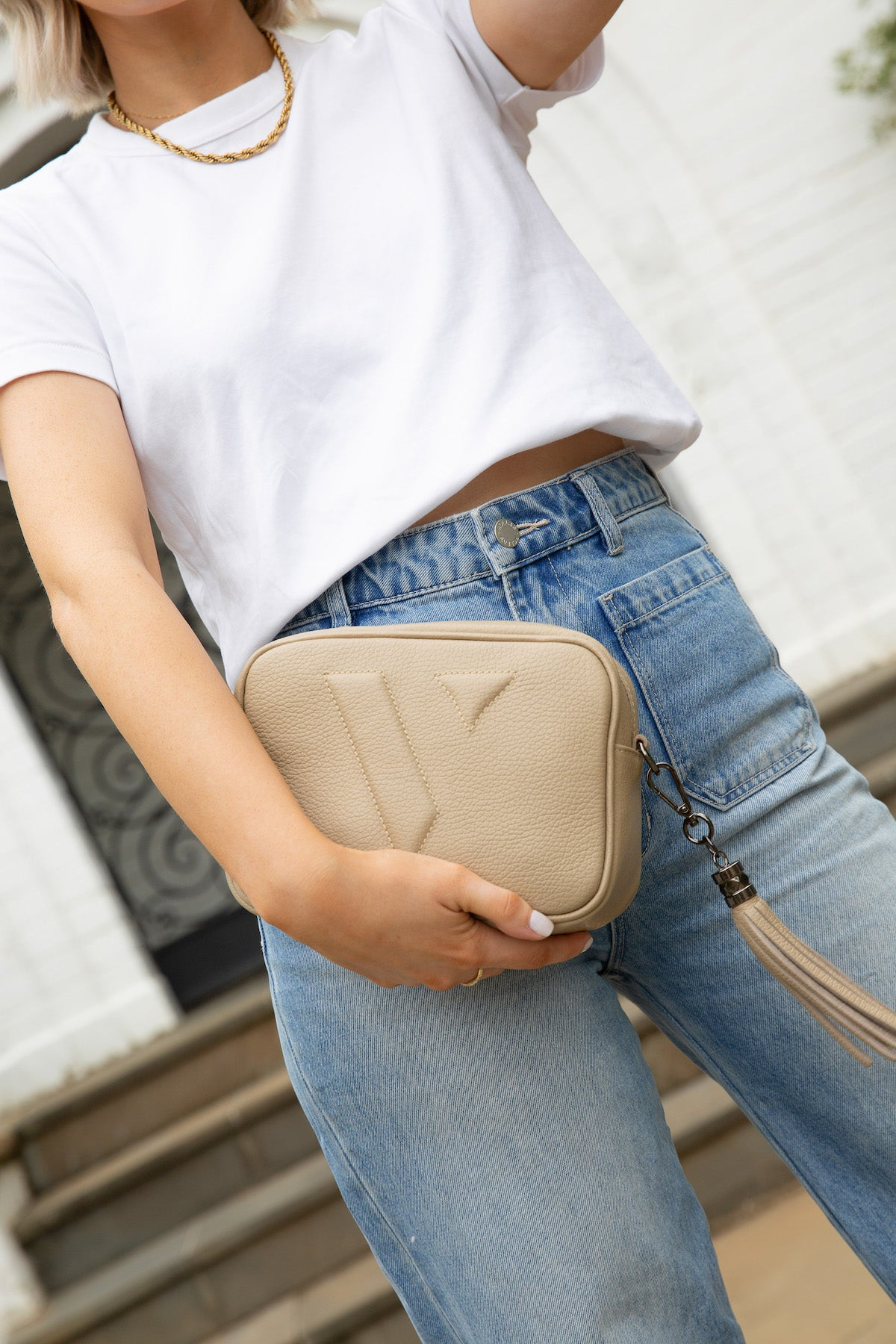 VESTIRSI VANESSA BEIGE CROSSBODY BAG WORN AS A CLUTCH