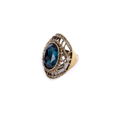 Bronze colored ring encrusted with dark blue stone and small Zircon stones -1293