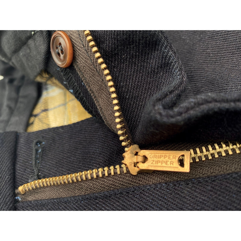 "Zip fly featuring a vintage-style brass metal zipper with ""Gripper Zipper"" pull."