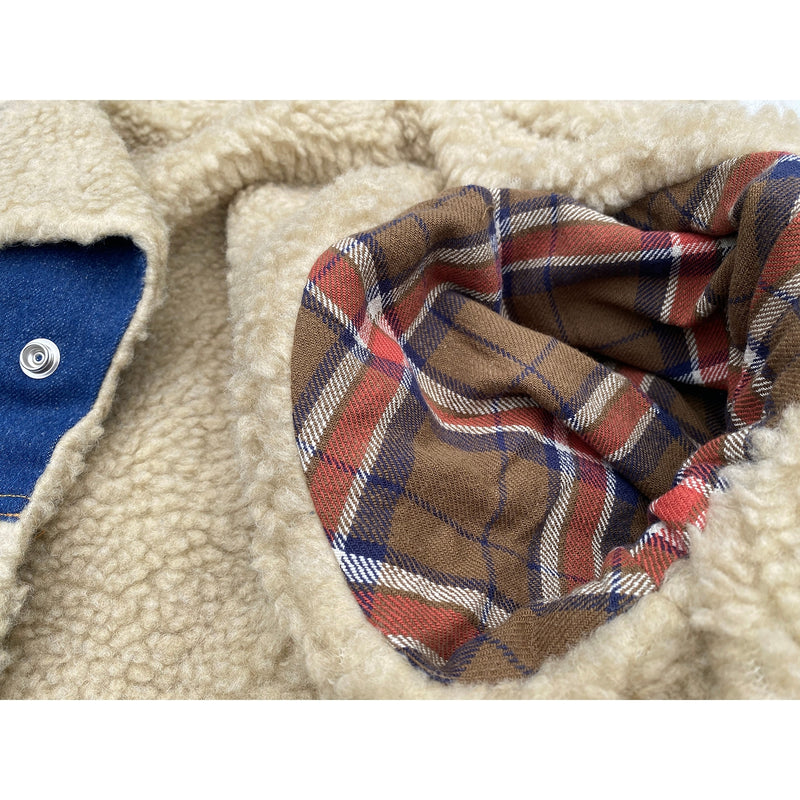 "Woven plaid cotton flannel fabric arm lining and Faux shearling fur body lining, 100% acrylic pile fabric, aka ""sherpa""."