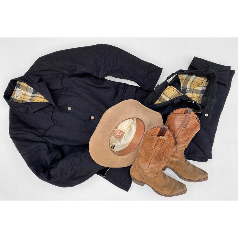 Pioneer Jacket and Deputy Pants in Midnight Denim with vintage western boots