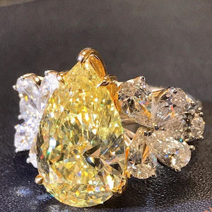 9 CT Pear Cut  Yellow Diamond Ring with White Diamond Cluster side Stones