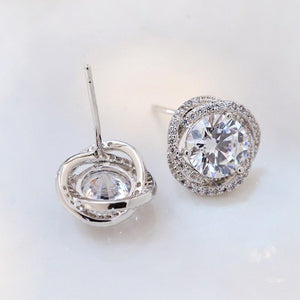 2.5 CT Round Cut Lab Created White Sapphire Twist Halo Stud Earrings in Sterling Silver