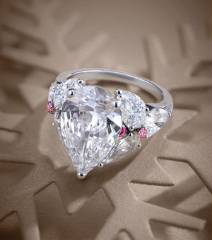 6.15 CT  Pear Cut White Ring features Pink Diamond Accents