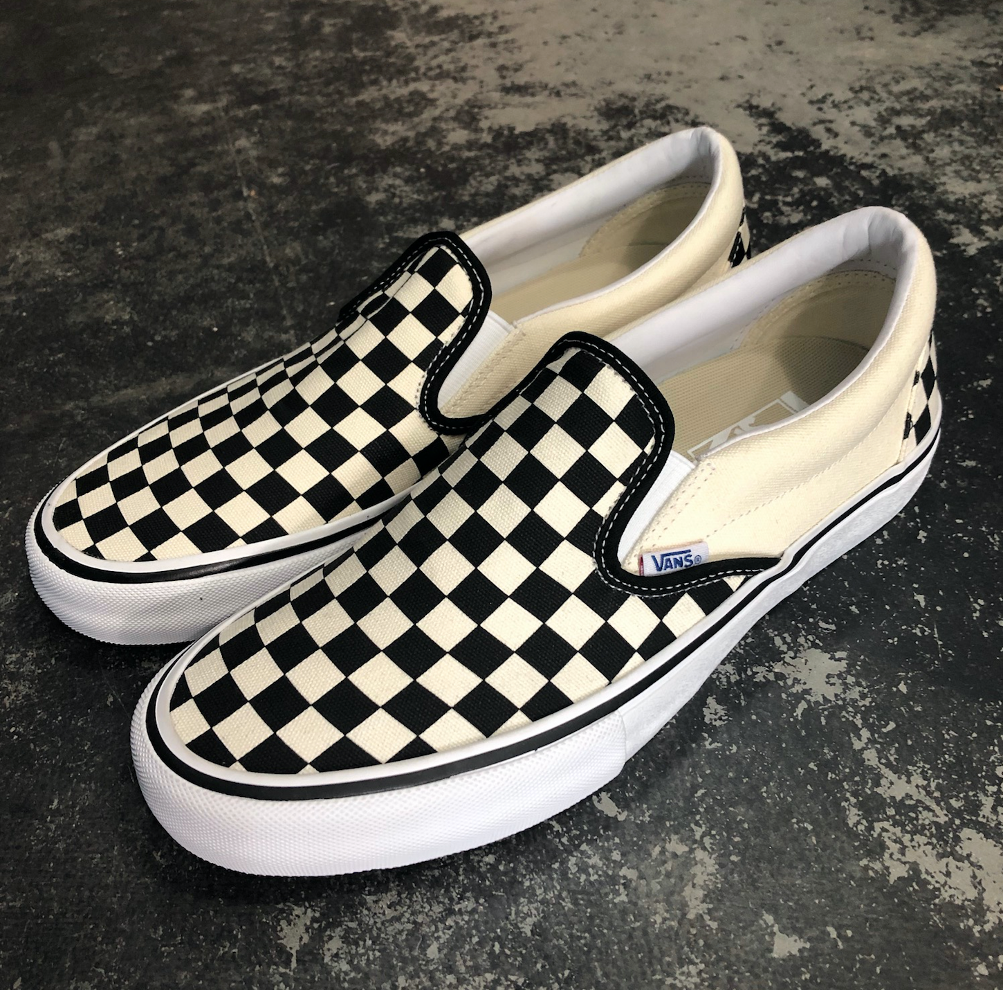 vans slip ons checkerboard black and white
