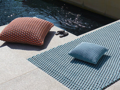 Ergonomic Shore Rug handmade from durable silicone cord suitable for both indoors and outdoors.