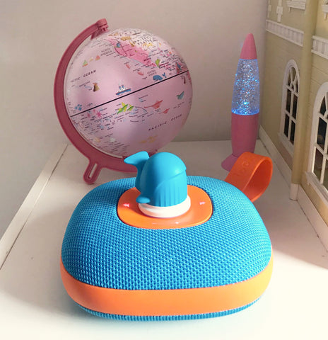 Jooki music player with Whale token, Pink Globe in background of kids room
