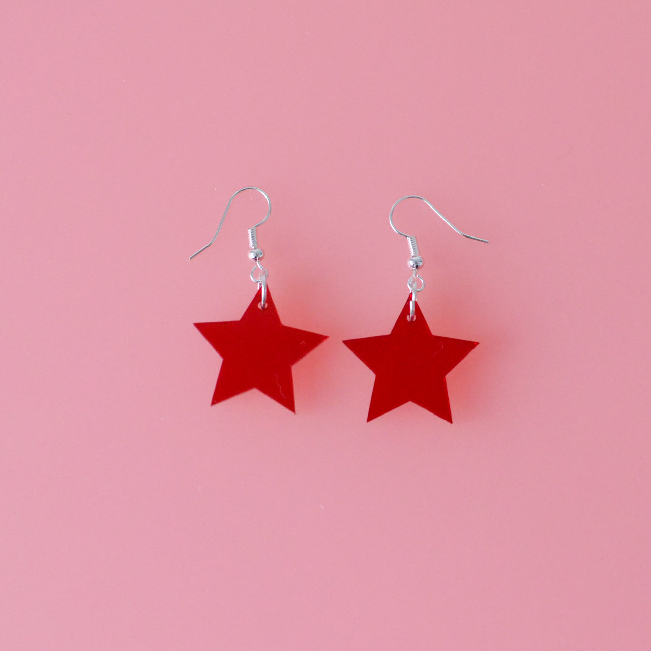 Mid Sized Red Acrylic Transparent Star Dangle Earring