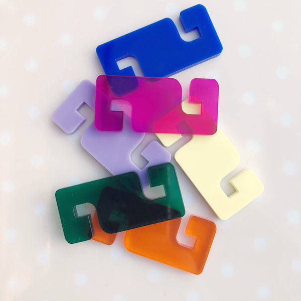Laser cut plastic ear saver clips for use with face masks in bright colourful colours