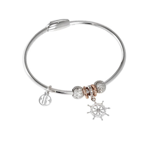 Bracelet with charm in zircons in the shape of the tiller