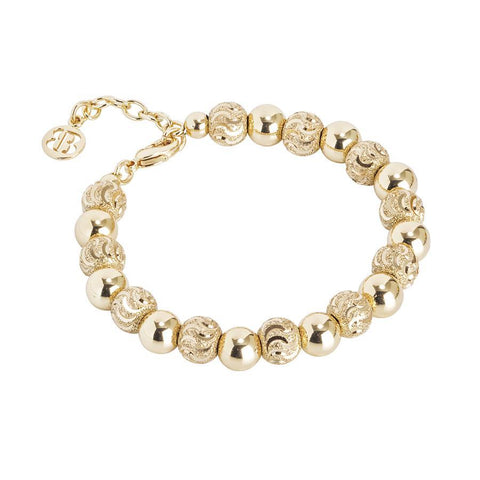 Bracelet with golden beads and diamond by the effect to wave