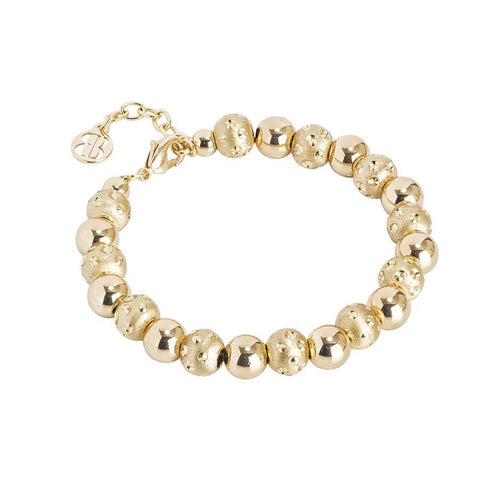 Golden Bracelet with smooth balls and diamond from the dimpled effect