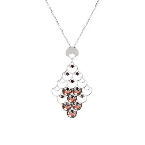 Long necklace rhodium plated with a pendant from the decoration scales