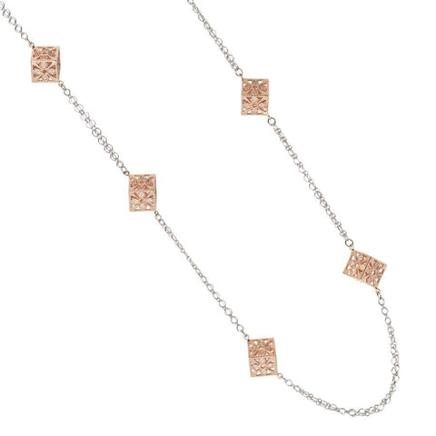 Long necklace with cubes in zircons interlayer