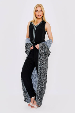 black jumpsuit and duster jacket