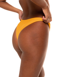 Minima bikini bottom in Mustard Yellow (side)