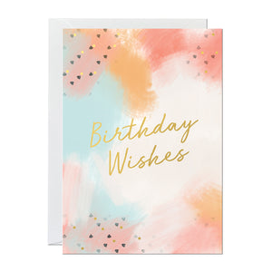 A birthday card featuring a hand-painted background and a gold foil greeting that reads 'birthday wishes'
