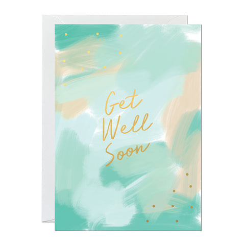 A get well soon greeting card that features a hand-painted green canvas background and gold foil lettering