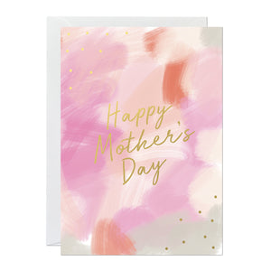 A mother's day card featuring a hand-painted canvas background and gold foil lettering that says 'happy mother's day'